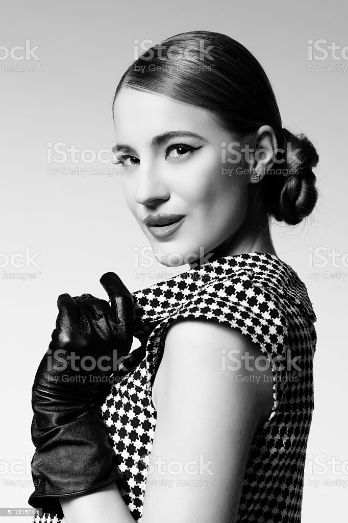 Retro girl in dress and gloves stock photo