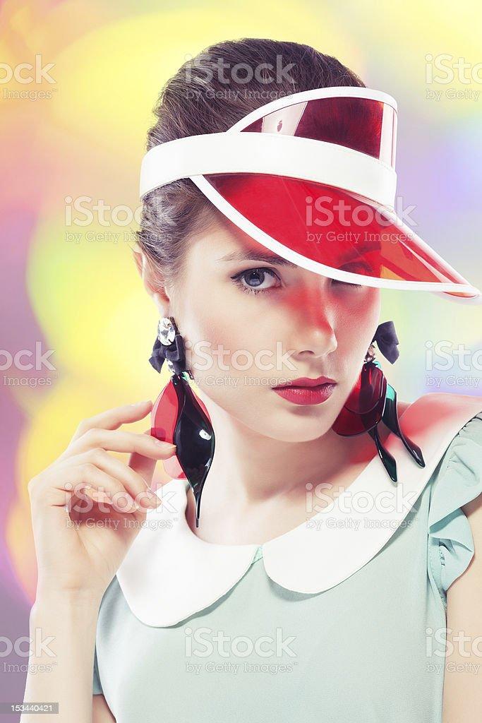 Retro girl in red sun visor stock photo
