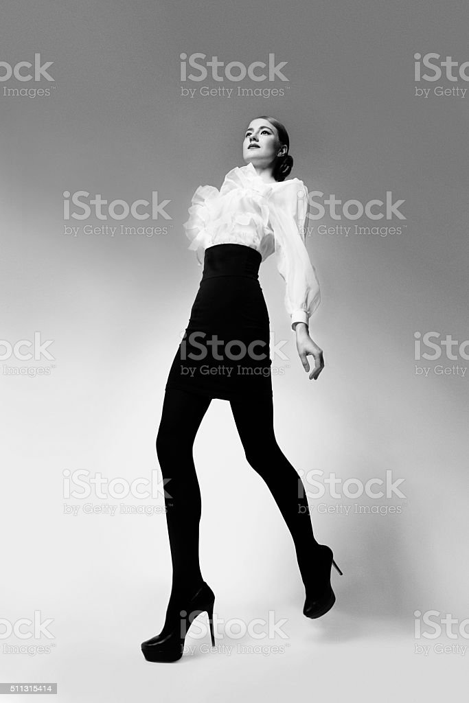 Retro girl in skirt and blouse stock photo