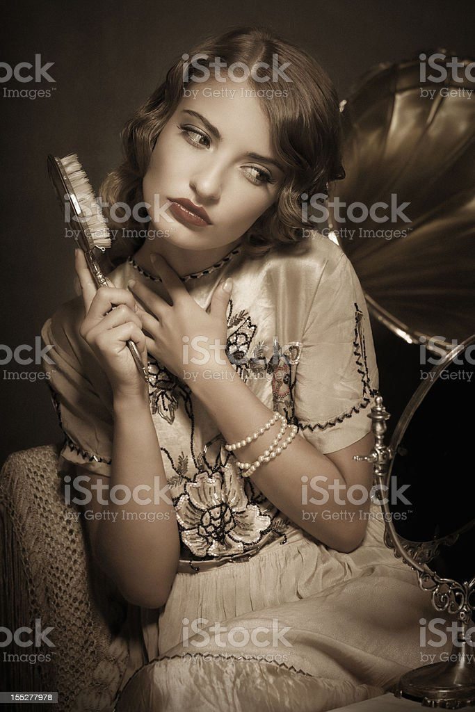 Retro girl listening to music and combing stock photo