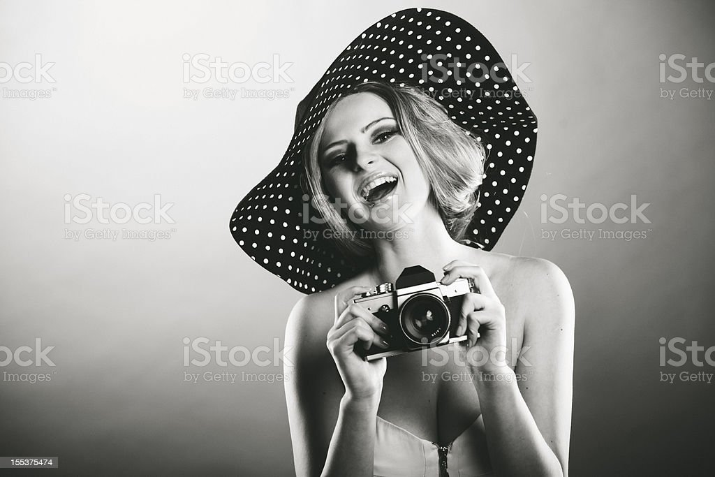 Retro girl with camera royalty-free stock photo