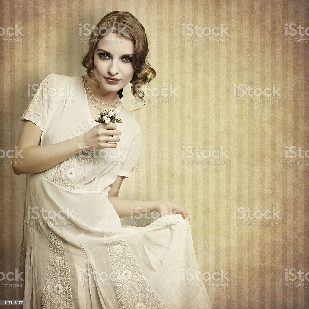 retro girl with small bouquet royalty-free stock photo