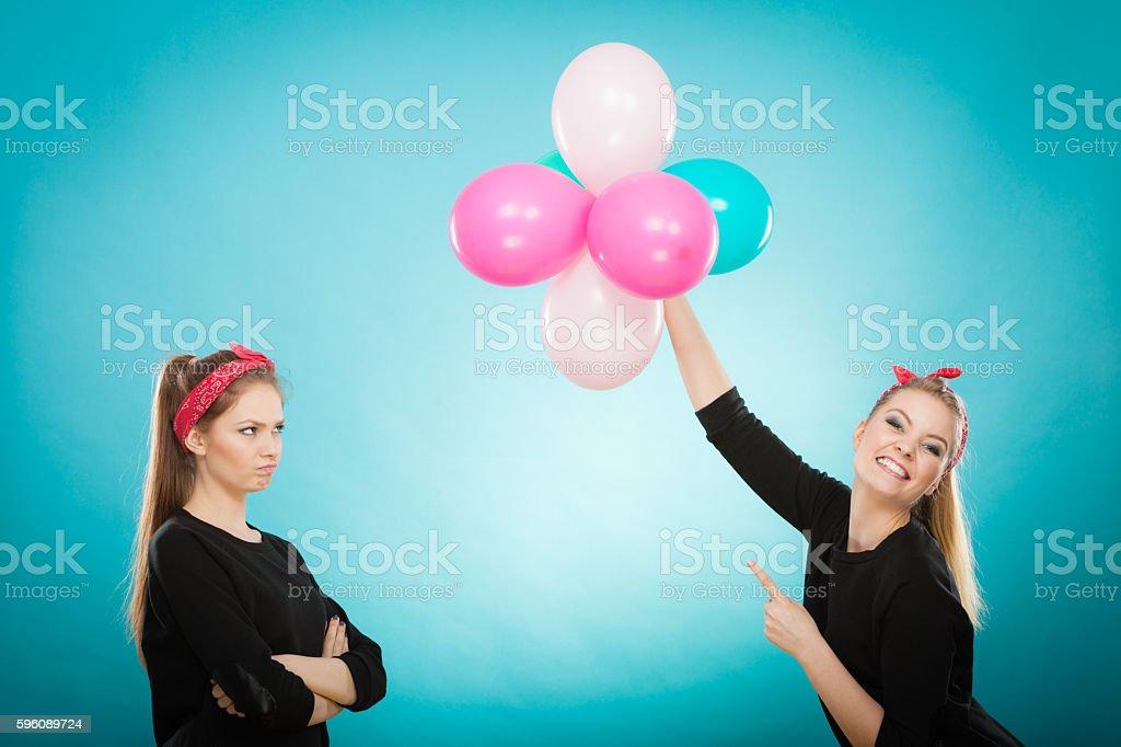 Retro girls preparing balloons birthday party. royalty-free stock photo