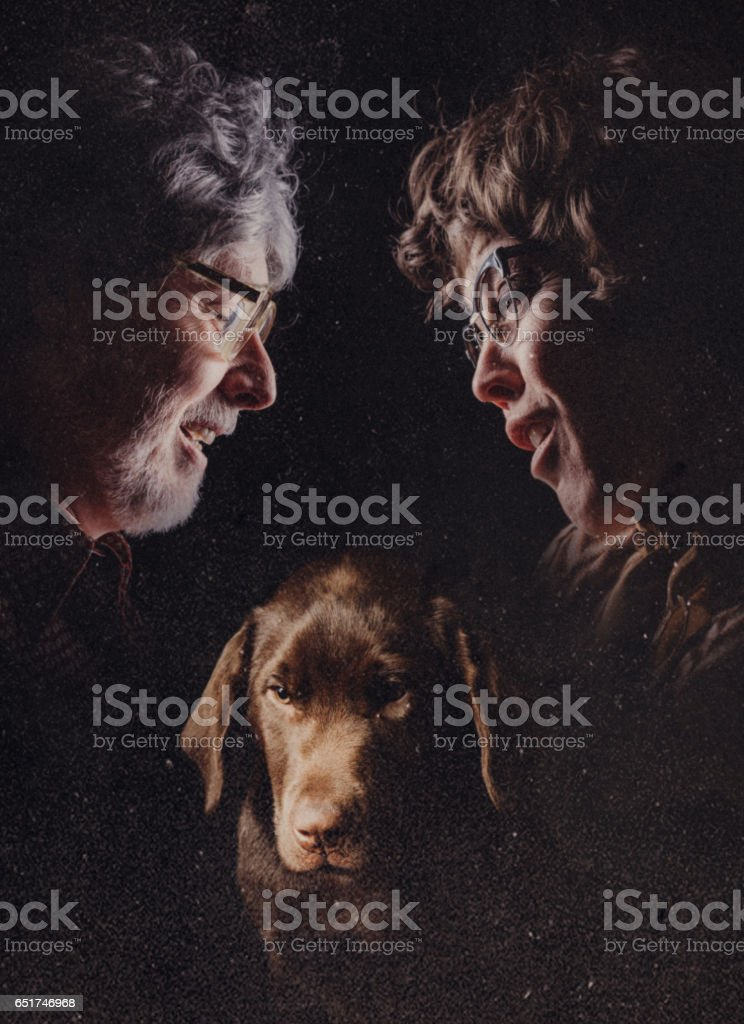 Retro Glamour Shot of Couple and Pet stock photo