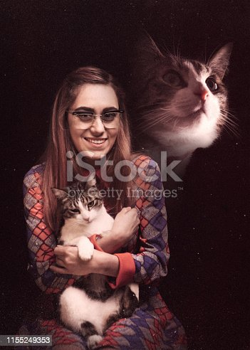 A vintage styled photograph of a woman posing for a portrait with her cat, a profile view of the cat superimposed at the top of the image.