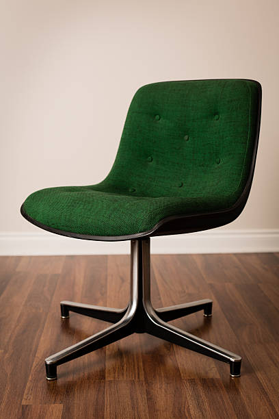 Retro Green Office Chair on Wood Flooring stock photo