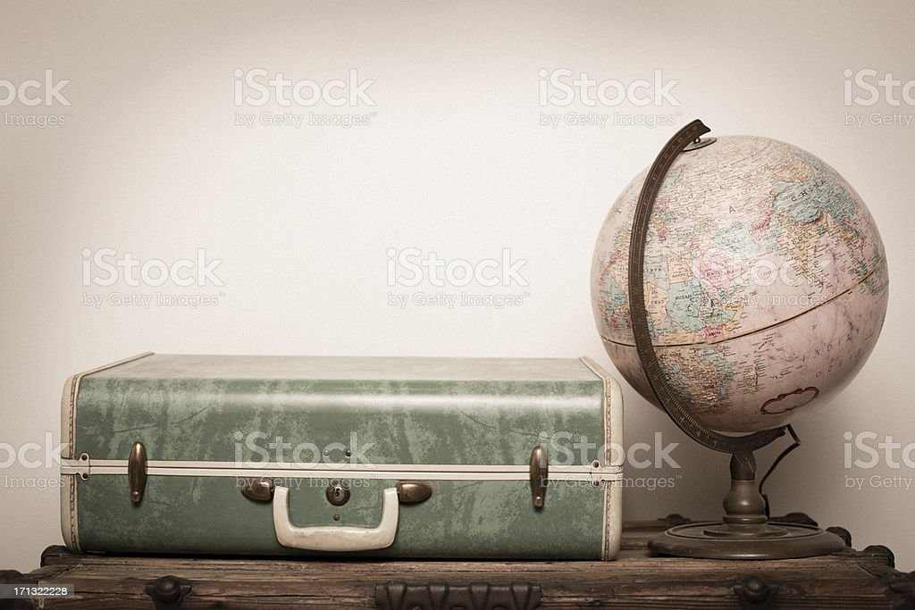 Retro Green Suitcase, Sitting on Wood, With Globe stock photo