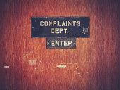 Retro Grunge Complaints Dept Door