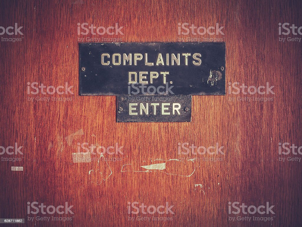 Retro Grunge Complaints Dept Door stock photo