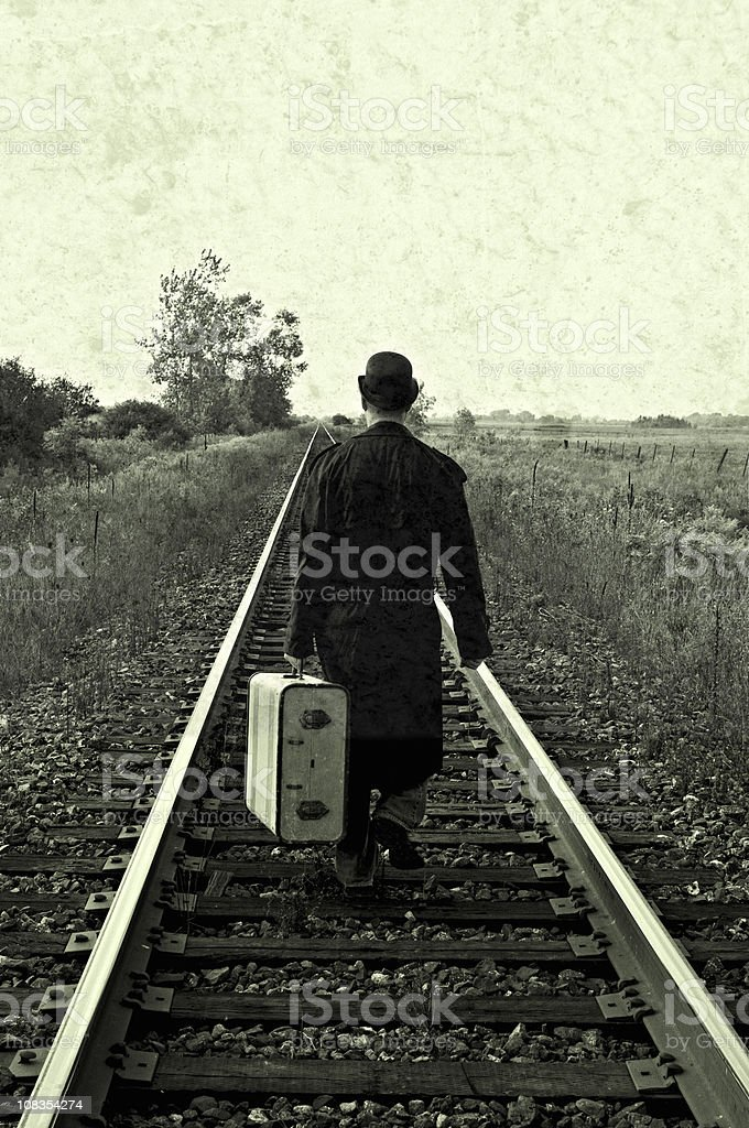 Retro Grunge Hobo, Vintage Suitcase on Train Tracks royalty-free stock photo