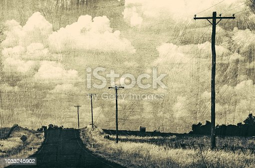 Vintage grunge retro style black and white road through rural landscape.
