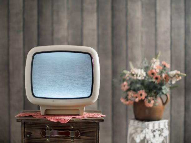 retro-grunge tv wand tapete - alte serien stock-fotos und bilder