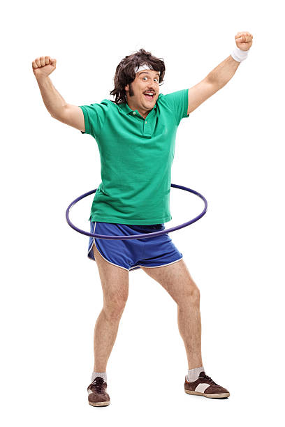 retro mann training mit einem hula-hoop - hula hoop workout stock-fotos und bilder