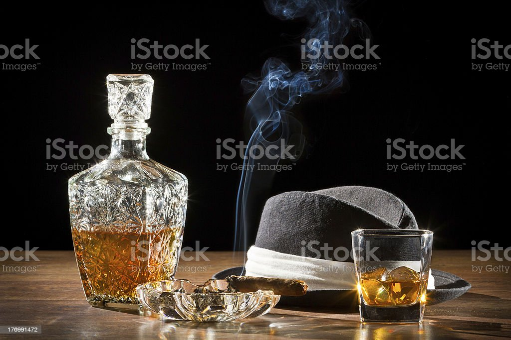 Retro hat, smoking cigar and whisky on rock royalty-free stock photo