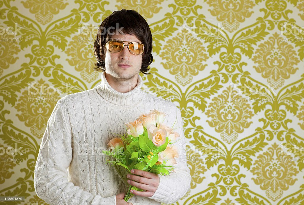 retro hip man holding valentines flowers stock photo