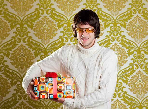 retro hip young man glasses holding  gift box - happy indie pop bildbanksfoton och bilder