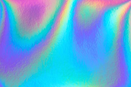 Retro holographic foil background, great design for any purposes. Abstract colorful vibrant blur iridescent gradient. Retro futuristic label design.
