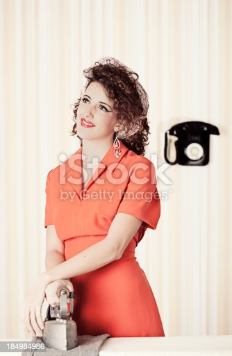 istock Retro house wife daydreaming while ironing. 184984986