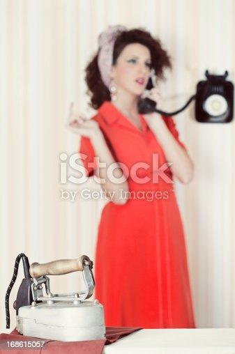 istock Retro house wife listening to the radio 168615057