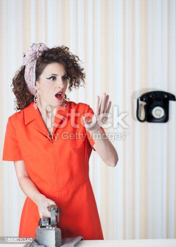 istock Retro house wife listening to the radio. 186825340