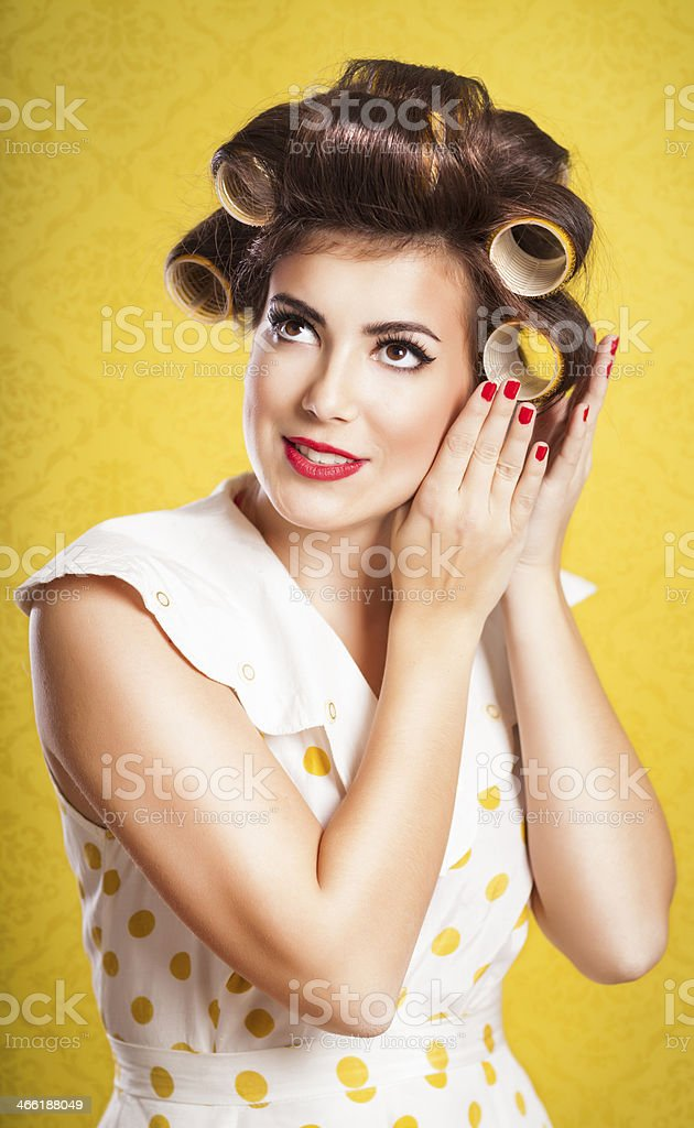 Retro housewife fixing up her hair stock photo