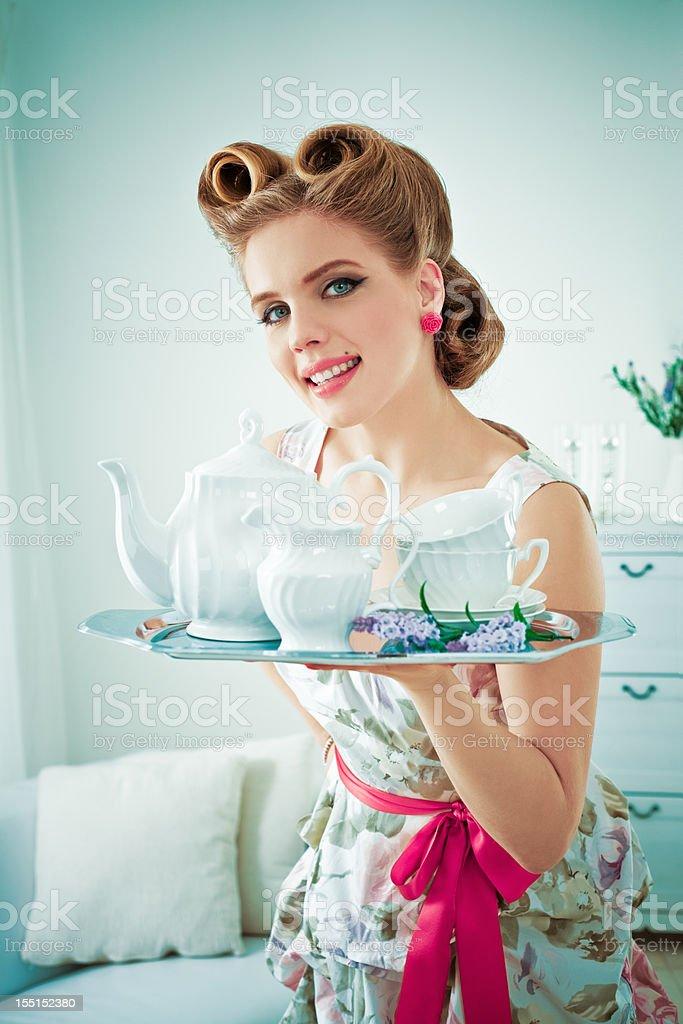 Retro housewife serving coffee stock photo
