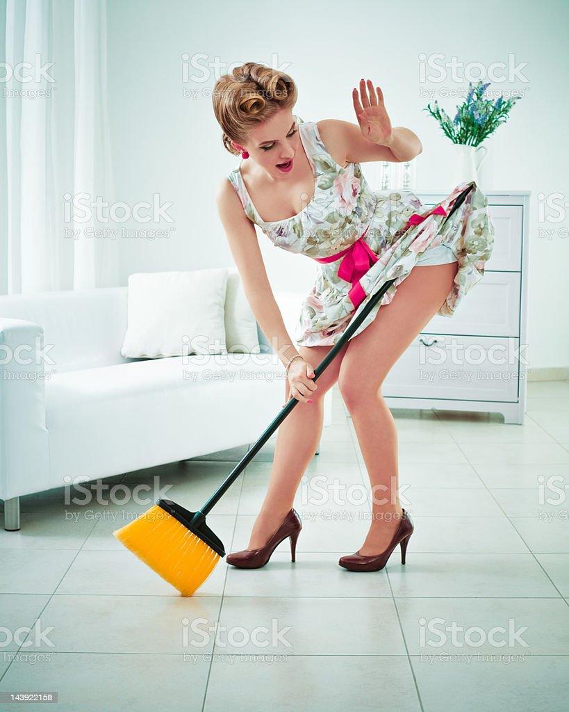 Retro housewife sweeping stock photo