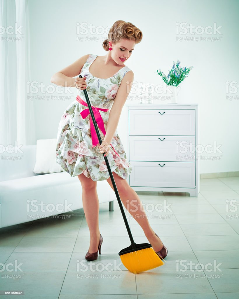Retro housewife sweeping stock photo