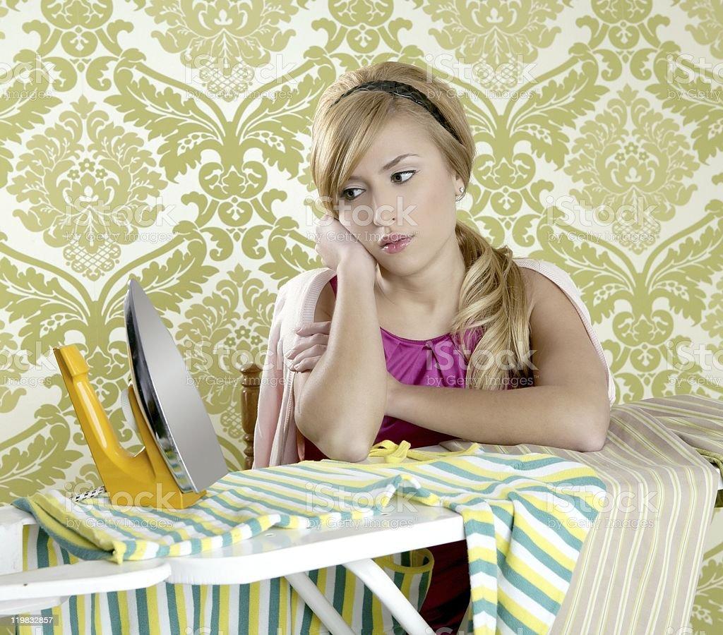 Retro housewife vintage woman clotes iron tired stock photo