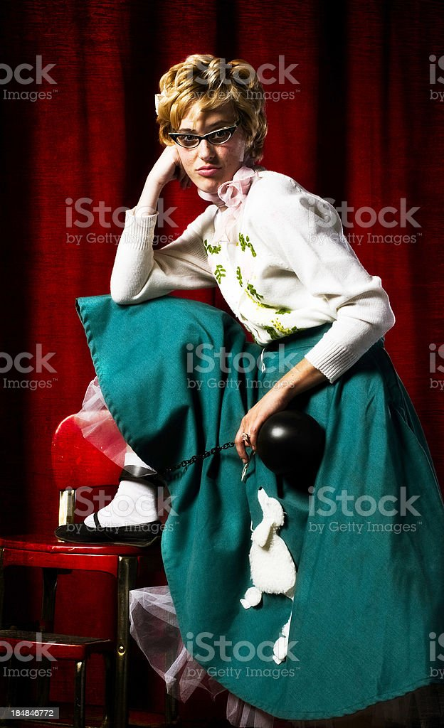 Retro Housewife with Ball and Chain Bored Expression stock photo