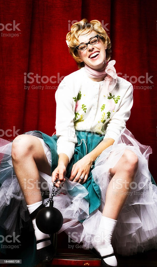 Retro Housewife with Ball and Chain Joyful Expression stock photo