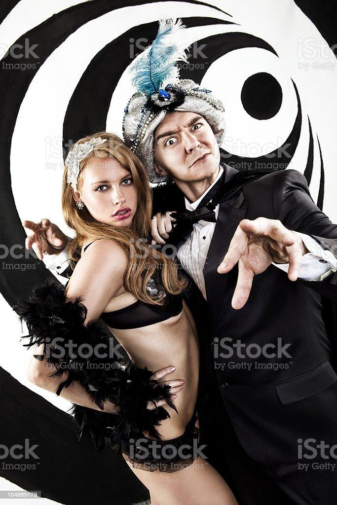 Retro Hypnotist and Beautiful Assistant stock photo