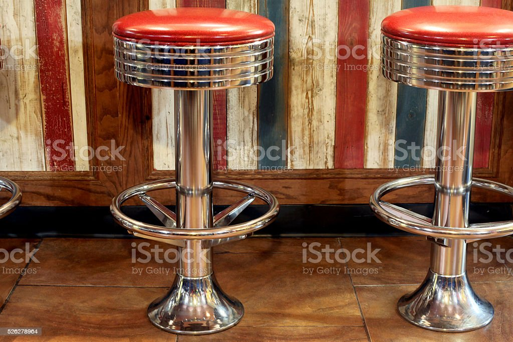 Retro ice cream shop stools.  Copy space on left. stock photo