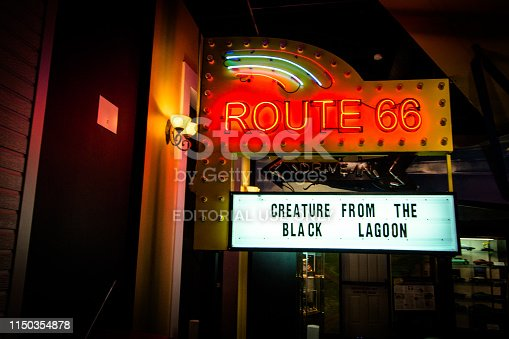 Elk City, Oklahoma, USA - April 27, 2019: Retro neon sign of a Route 66 drive in at the Historic Route 66 Museum in Oklahoma. The historic highway went from Chicago to Los Angeles and was know as the Main Street of America.