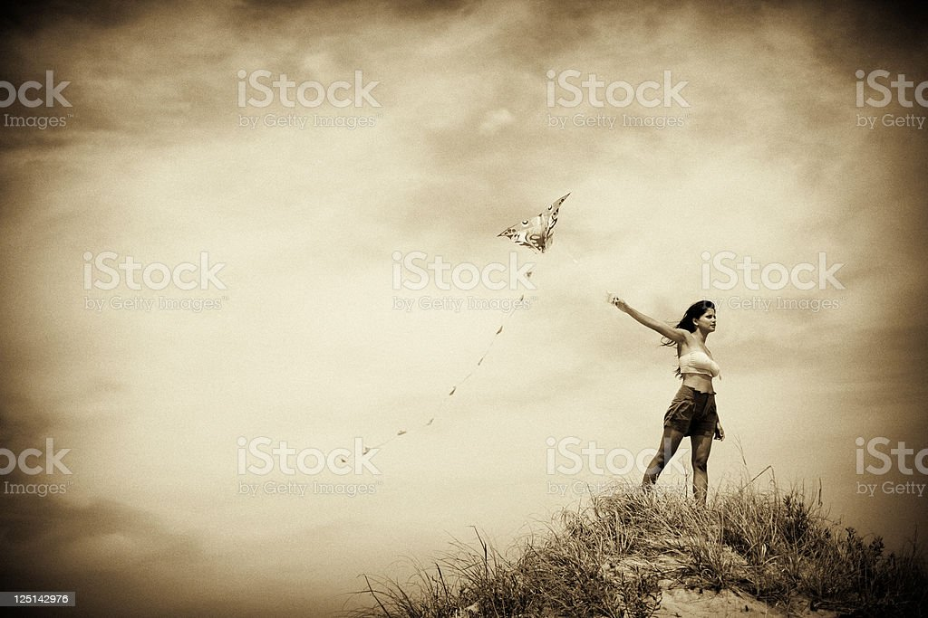 Retro image of woman flying a kite stock photo