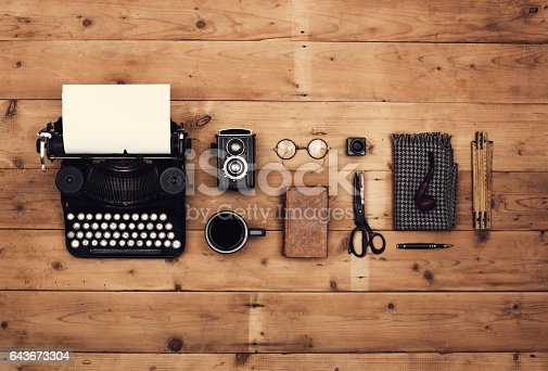 top view retro typewriter and other old items header on old wooden background