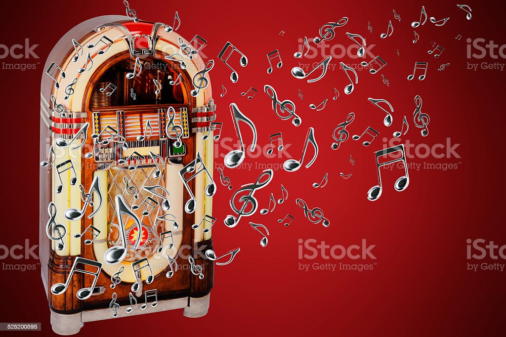 Retro jukebox with many flying musical note against red background stock photo