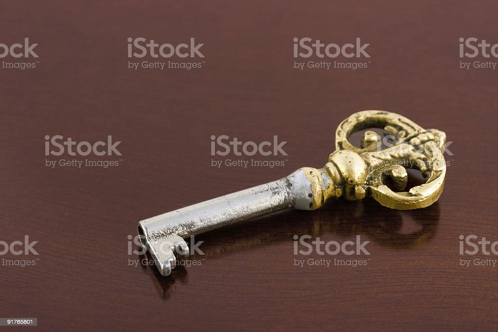 Retro key on wooden table royalty-free stock photo
