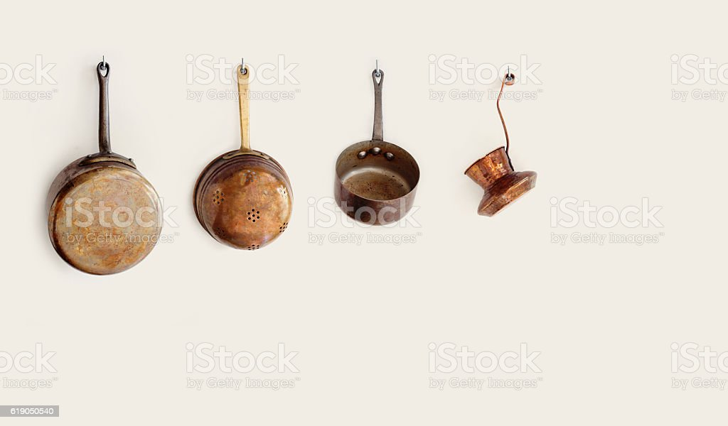 Retro kitchen utensils hanging on a hooks. Old style accessories stock photo