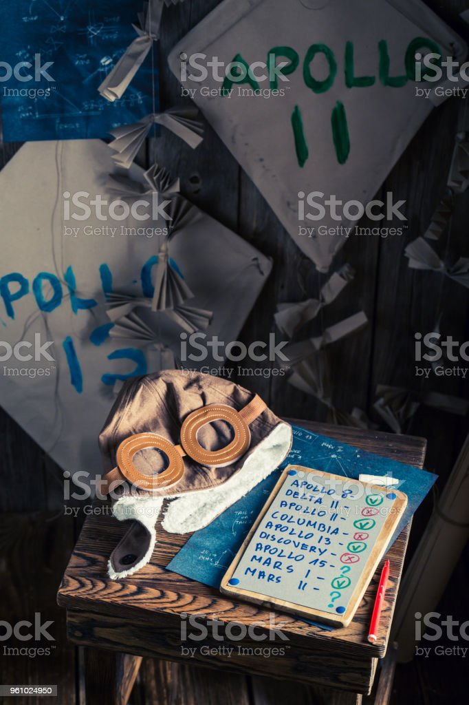 Retro kites with space missions names in wooden workshop stock photo