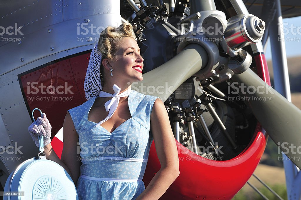 retro lady and biplane aircraft stock photo