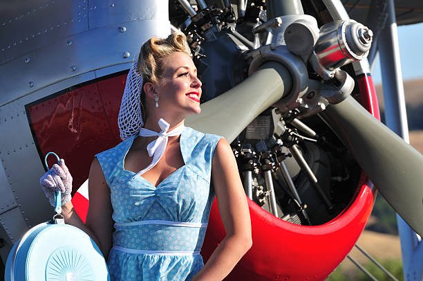 retro lady and biplane aircraft - 1940s style stock photos and pictures