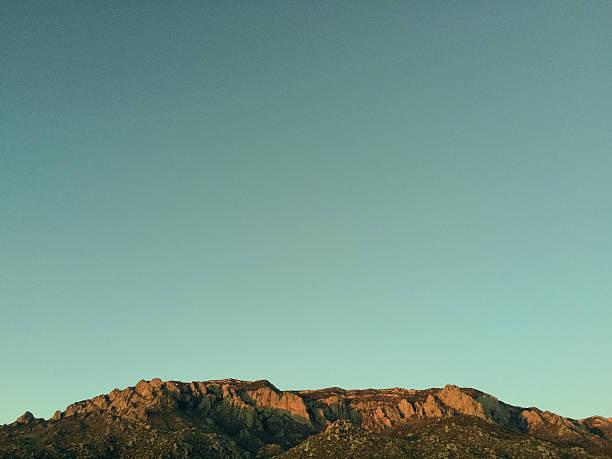 retro landscape abstract new mexico mountain sunset stock photo