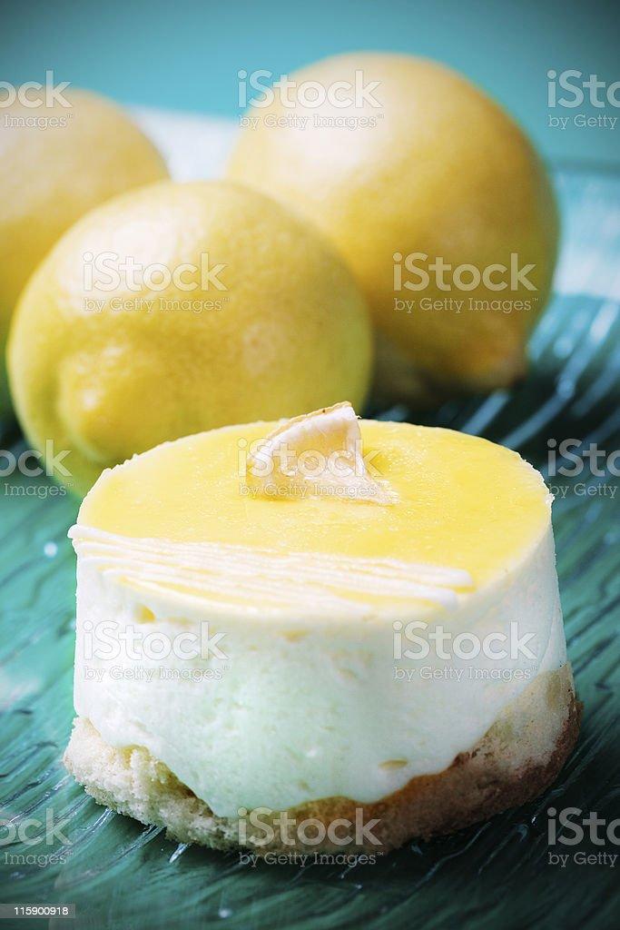 Retro lemon cake with fresh lemons royalty-free stock photo