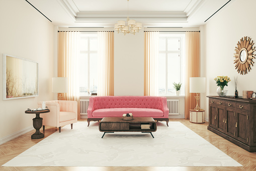 Art deco style living room with pink sofa and armchair.