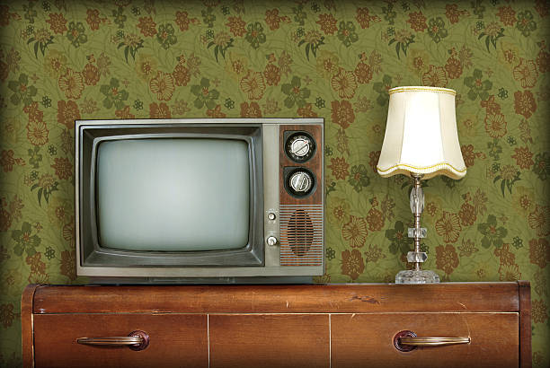 retro living room with a tv and a lamp atop a wooden desk - 1970s style stock photos and pictures