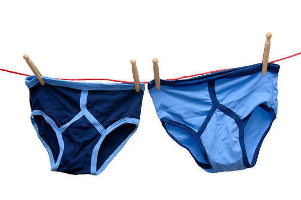 retro male underwear isolated  on washing laundry line - washing line stock photos and pictures