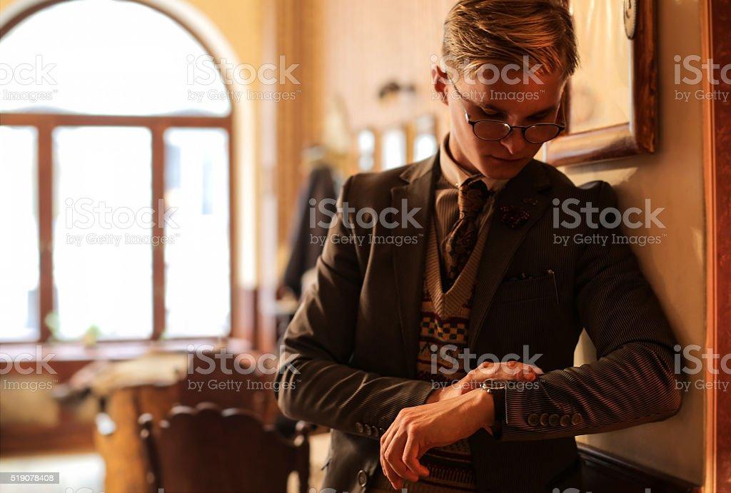 Retro man checking the time stock photo