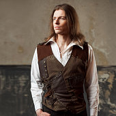istock Retro man portrait over grunge background. Steam punk style. 688597028