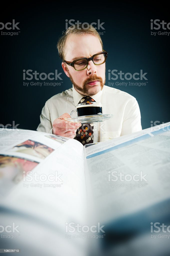 Retro man reading his newspaper royalty-free stock photo